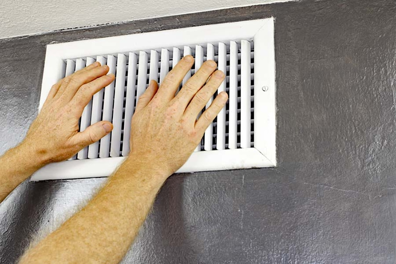 Hands on white air vent