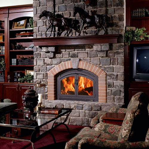 Large Brick fireplace inside a darn brown, oak colored living room.